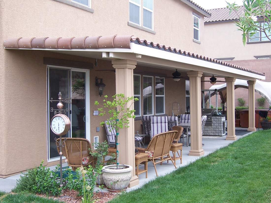 A stunning, modern patio cover with tiled roof, in a beautifully manicured yard.