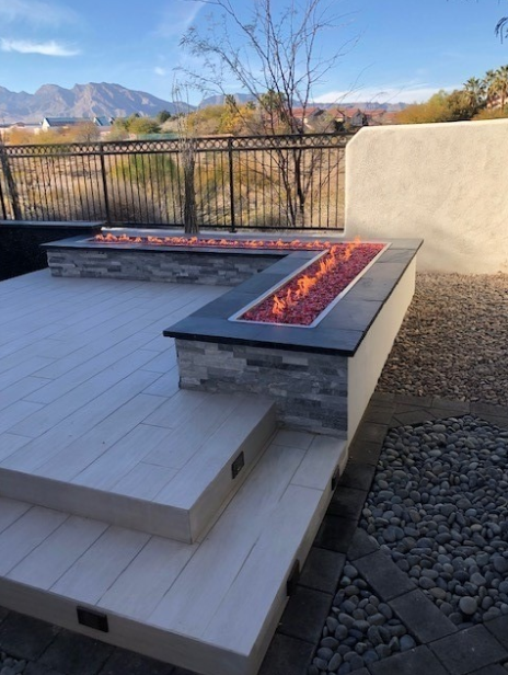 A shaded, raised deck with fire feature.